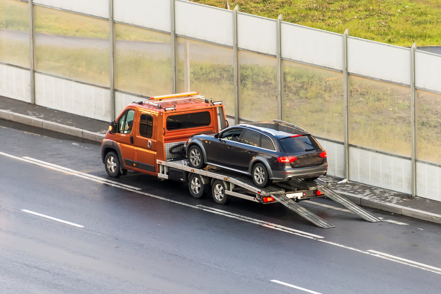 A tow truck towing a car